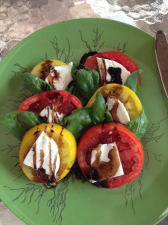 Tomato in a Caprese salad (with homegrown basil).